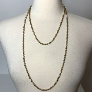 Long Strand Goldtone Metal Beads Approximately 52""